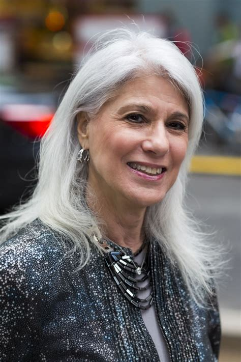 women in their 30s with gray hair celebrating women with long grey hair