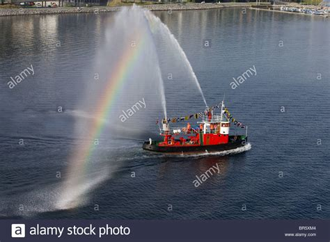 fire tug boat spraying water as a send off for cruise ship - Fire Boat Spraying Water