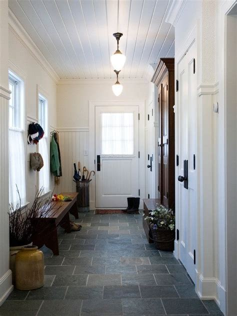 mud room entry beadboard on walls and ceiling slate