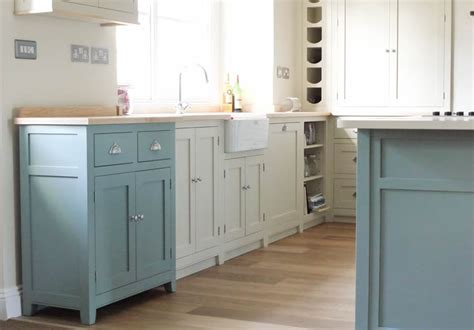 Birch plywood cabinets with hand painted hardwood frames farrow and