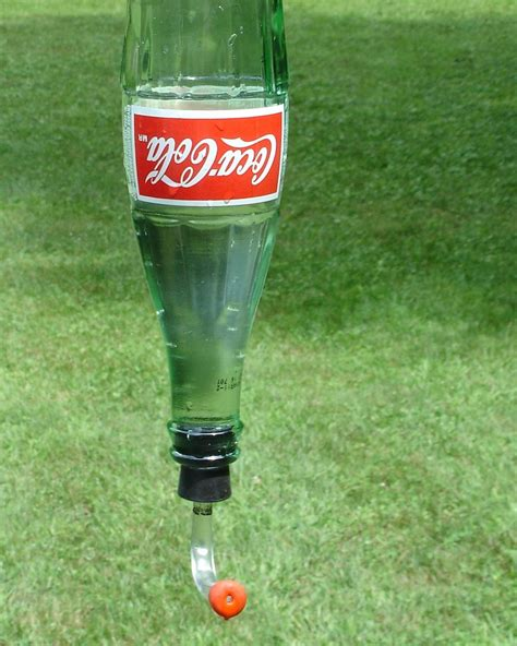 hummingbird feeder from recycled coke bottle