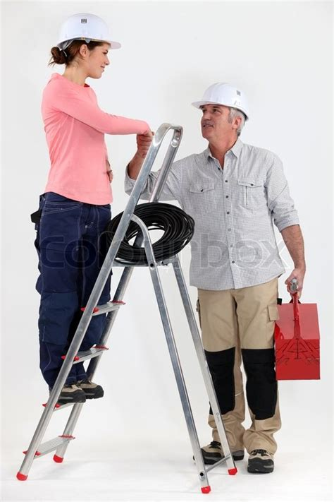Helper Electrician by Electrician Welcoming Helper Stock Photo Colourbox