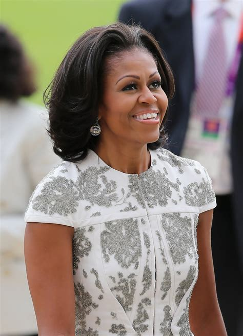 michelle obama haircut michelle obama medium layered cut michelle obama hair