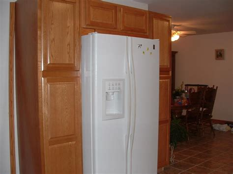 kitchen cabinets around refrigerator cabinets build around a white refrigerator dont like the