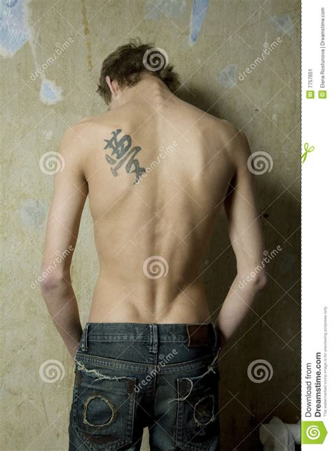 xs tattoo prices man with tattoo on the back stock image image of despair