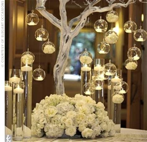 all white tree centerpiece with tea lights surrounded by