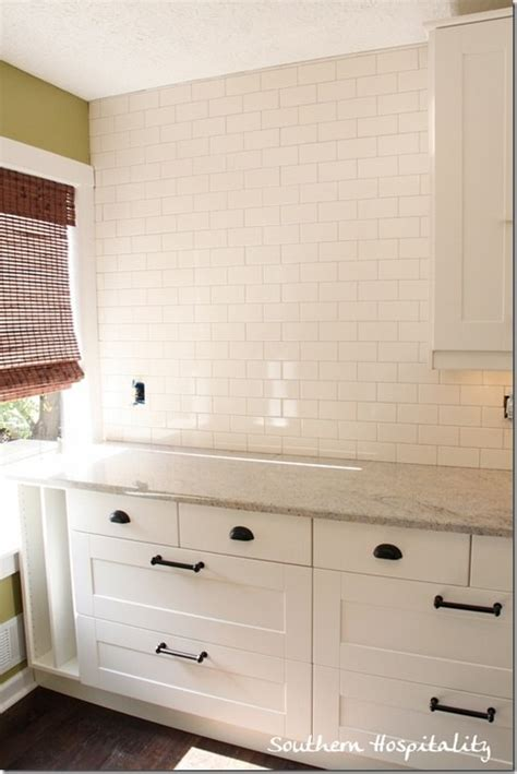 installing subway tile backsplash in kitchen how to install a backsplash the budget decorator