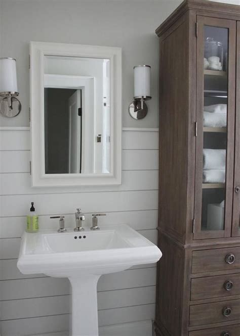 beautiful bathroom features upper walls painted gray