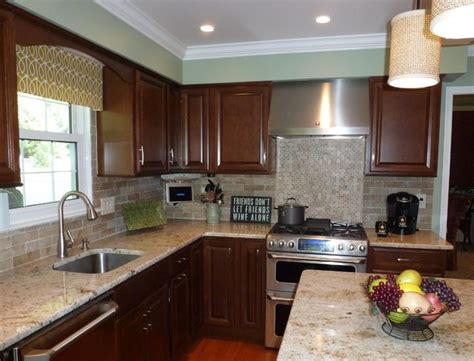 colonial gold counters with faux brick backsplash