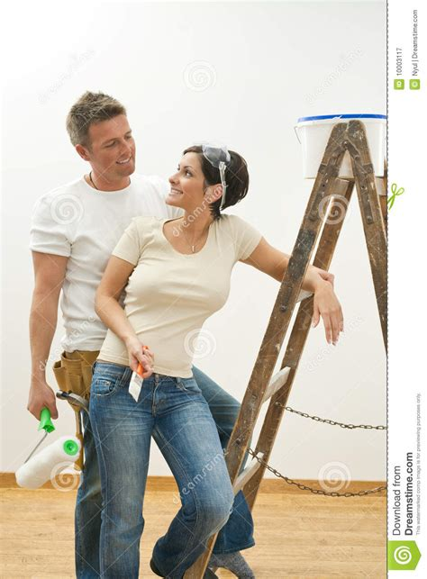 painting at home happy couple painting first home stock image image 10003117