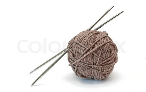 knitting needles and yarn skein of yarn and knitting needles on a white background