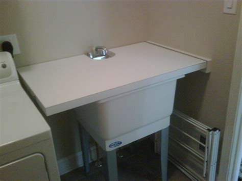 utility sink laundry room turn utility sink into folding surface countertop