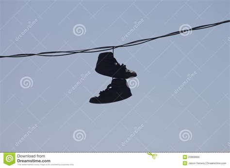 hang photos from wire shoes hanging on wire stock photo image of blue outdoor