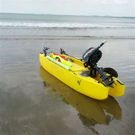 kayak motor boat fishing kayak outfitted with a mercury outboard motor