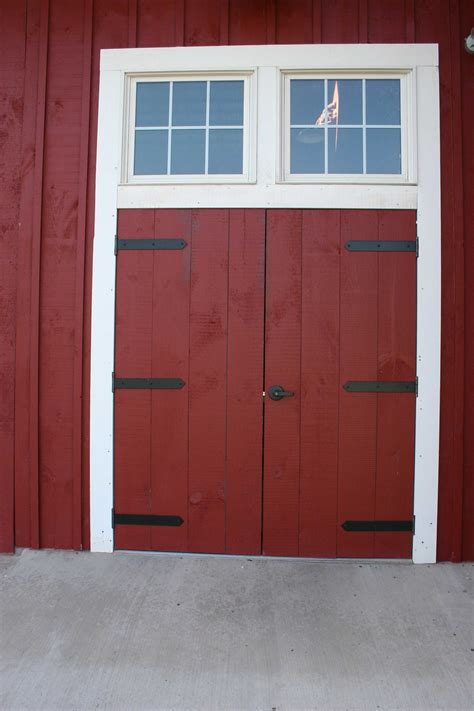 Swinging Barn Doors Swing Barn Door Home Design Ideas Swinging Barn Door Hardware