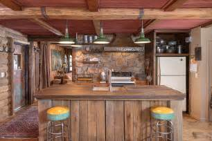 Rustic kitchen with wood counters pendant light restoration hardware
