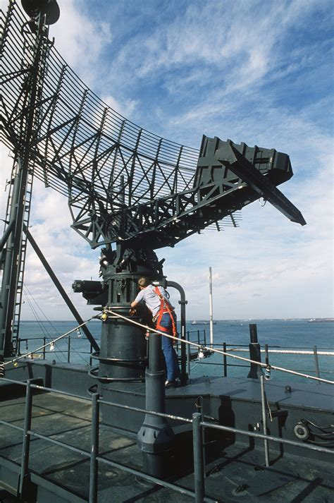 a crew member services the sps 49 air search radar antenna aboard the battleship uss iowa bb 61