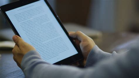 reading on tablet reading ebook on digital tablet in office by