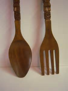large wooden fork and spoon wall hanging