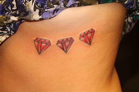 tattoo red diamond three red diamond tattoos on girl side neck
