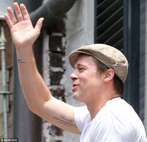 brad pitts tattoos brad pitt reveals two new tattoos with