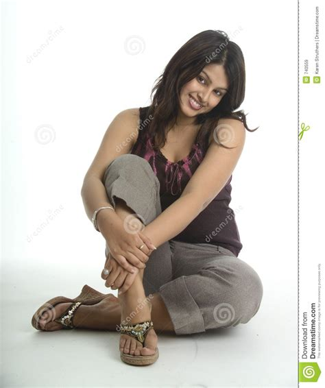 pretty sitting on the floor royalty free stock images