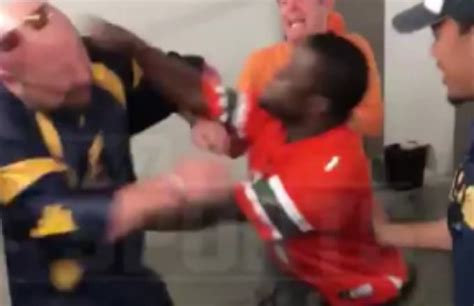 officer punches miami fan miami fan punches west virginia fan with prosthetic leg in