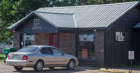 red room tattoo investigating early morning armed robbery at