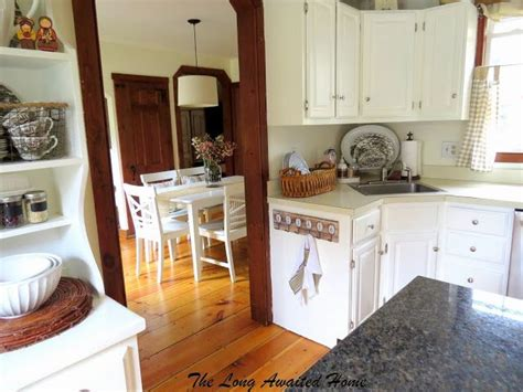 White Cupboards With Wood Trim - white kitchen reveal white painted cabinets and furniture