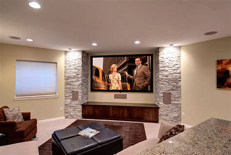 the big screen tv is anchored by walls on either