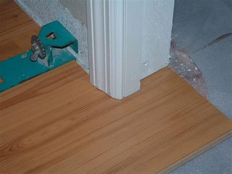 how to lay laminate flooring through a doorway blog