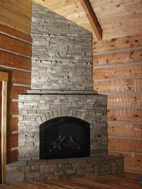 stone corner fireplace corner fireplace in stack stone old barn board ideas
