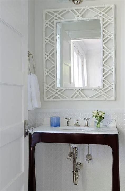 brown vanity with white bamboo mirror transitional