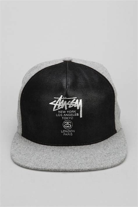 awesome faux leather snapback hat from stussy urbanoutfitters caps leather