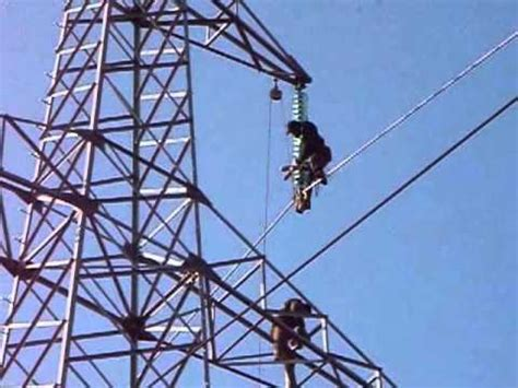 two persons climb extra high voltage 220 kv electricity