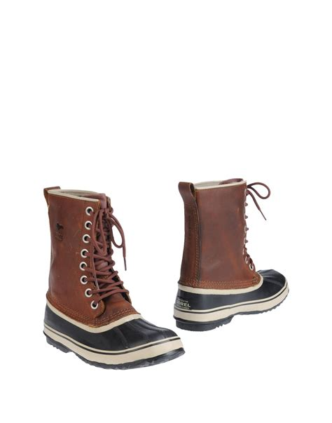 sorel ankle boots in brown lyst