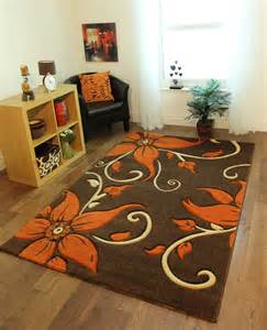 brown burnt orange beige floral motif quality rugs stain