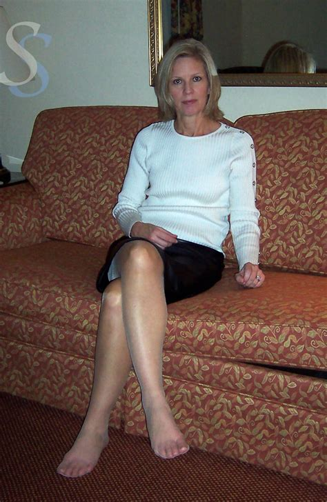 older celebrity feet mature moody blonde in pantyhose sits with her legs
