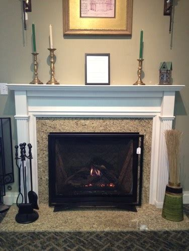 simple and affordable granite fireplace uses about 20