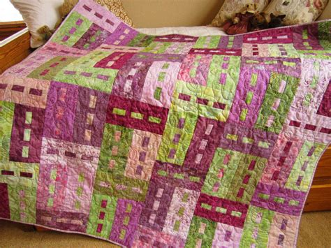 Green Patchwork Quilt - batik patchwork quilt purple and green from thecraftstar
