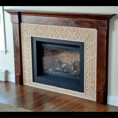 custom made carved marble tile fireplace surround by