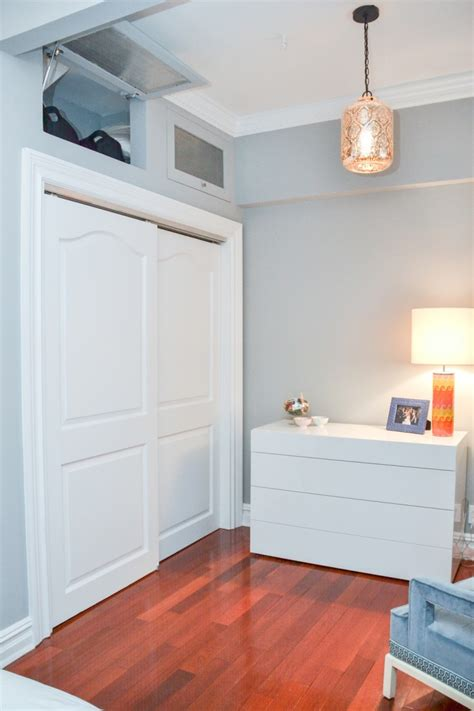 Above Closet Storage by How To Live Large In A Small Apartment