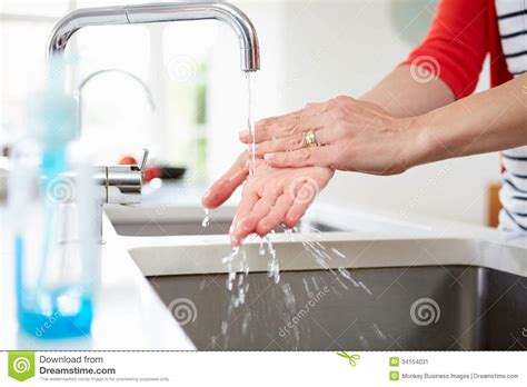 Close Up Of Woman Washing Hands In Kitchen Sink Stock Image   Image of faucet, working: 34154031