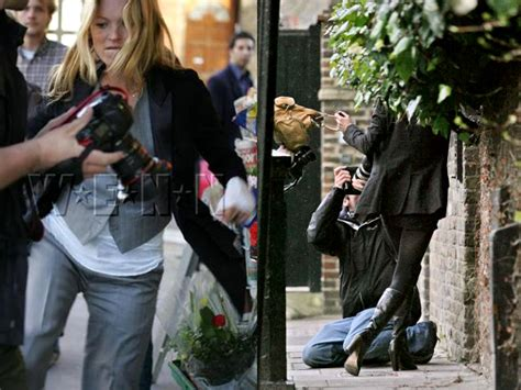 Attacks The Paparazzi With Umbrella by Attacking Paparazzi
