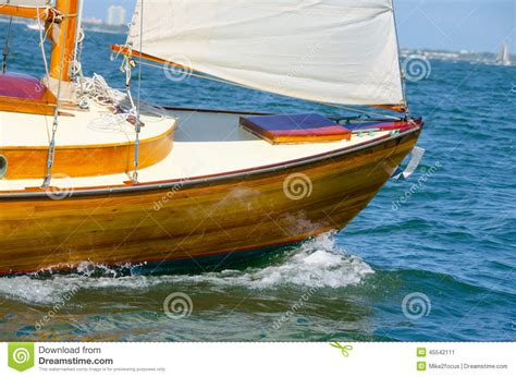 through the water and the a boat sailor s story books shiny varnished wooden sailboat bow sailing stock photo
