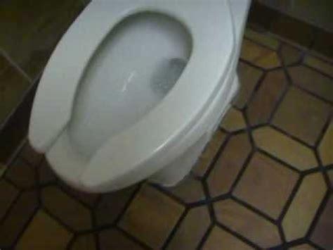 toilet in cing man pisses on floor of burger king doovi