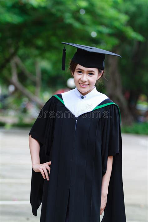 female graduate wear graduation cap stock photo image