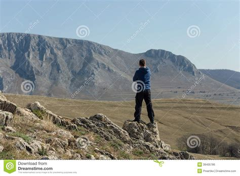 man standing on mountain top man standing on top of mountain stock photo image 39405786