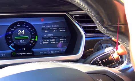 tesla park pushing the tesla park button while vehicle is in motion