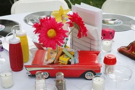 Car Centerpiece With Vintage Candy And Gerbera Daisies Classic Car Centerpieces